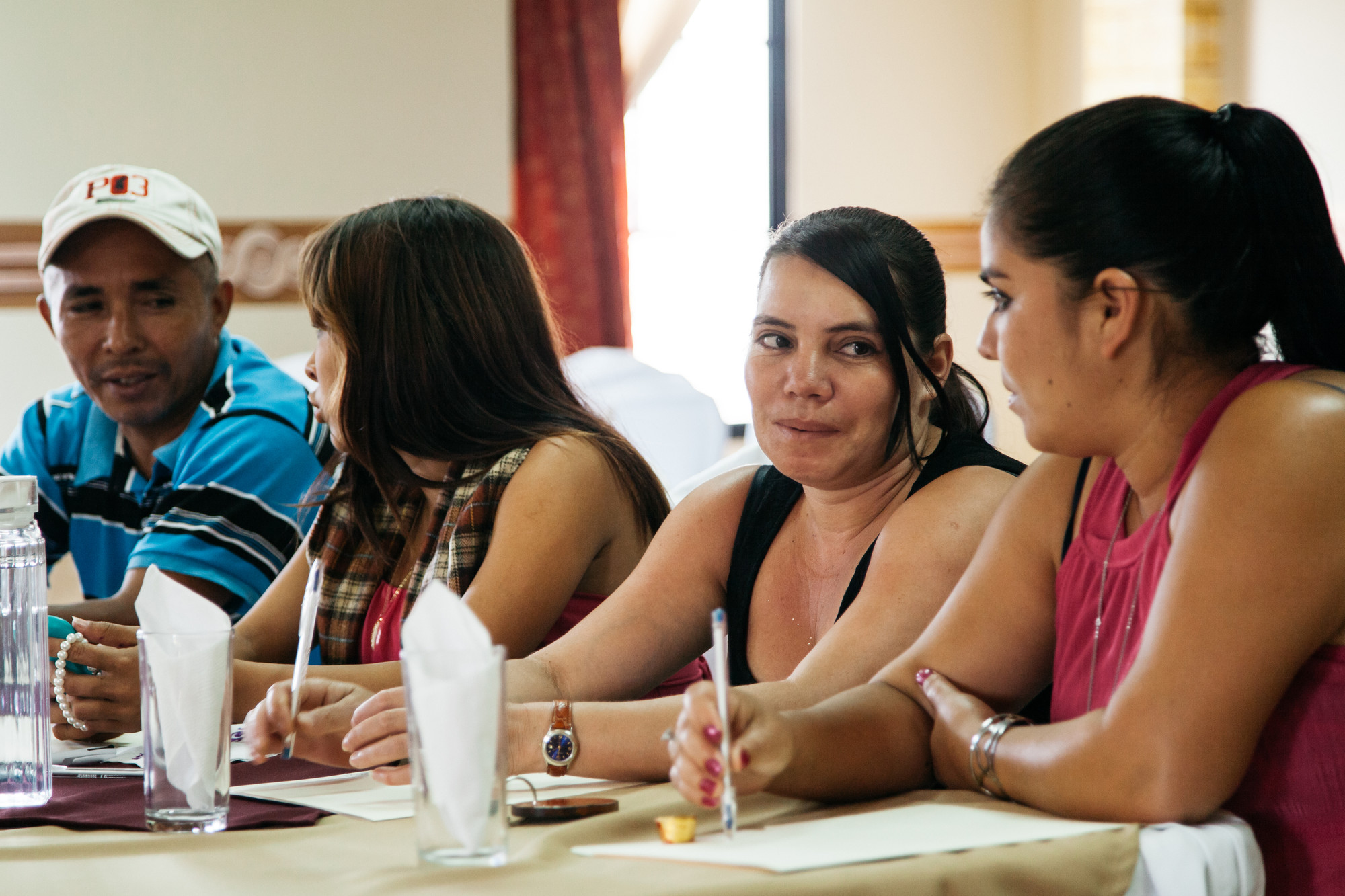 Men and women take part in a workshop together in the city of Santa Rosa de Copan.