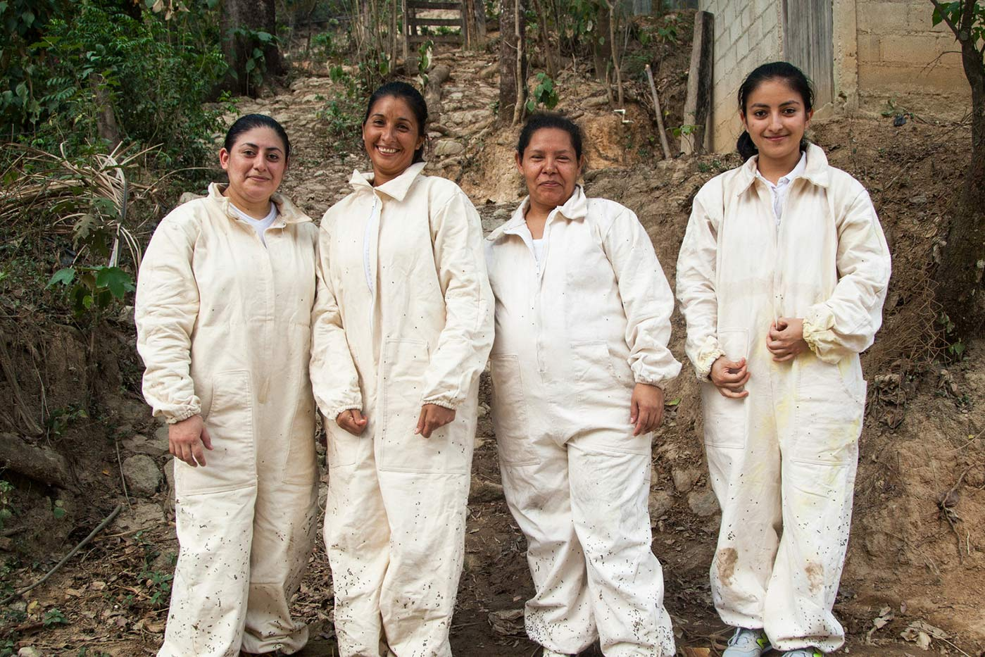 Project participants Norma Martínez, Juana Confesora Díaz, Teresa Vásquez, and Dunia Martínez, who tend to honey producing bees,pose together near their beehives in the municipality of Candelaria